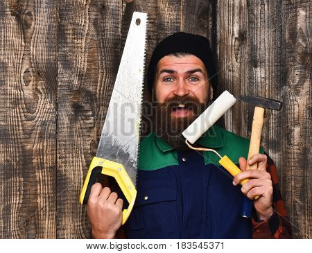 Bearded Builder Holding Various Building Tools With Happy Face