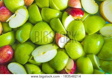 Apple sliced. Soaked apple in water. Texture Background