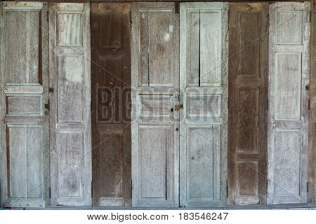 Old wooden door of the dilapidated home. Old house.