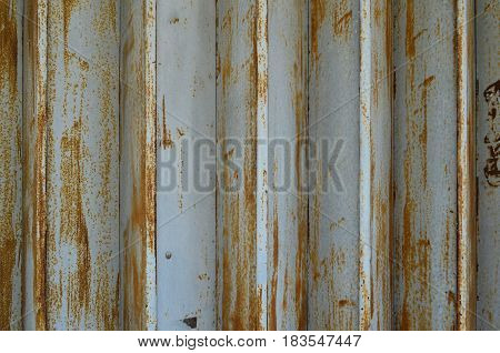 Rusty and weathered metal sheet wall texture