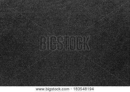 abstract background and speckled or mottled texture of fabric or textile material of black color