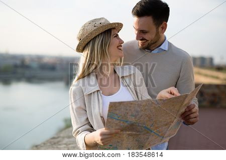 Beautiful tourist couple in love traveling and sightseeing