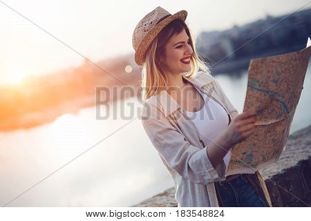 Happy beautiful blond woman traveling and sightseeing