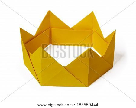 Origami paper yellow gold king crown irony on a white background