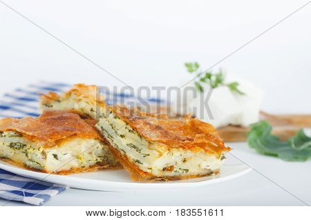 Delicious pie with spinach and feta cheese, traditional Greek, Serbian or Bulgarian cuisine.
