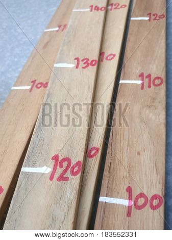 Close up of handmade wood measure soft focus