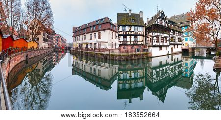 Panorama of traditional Alsatian half-timbered houses with mirror reflections in Petite France in the morning, Strasbourg, Alsace, France