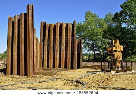 Huge metal piling for a construction project have been driven deep into the ground.