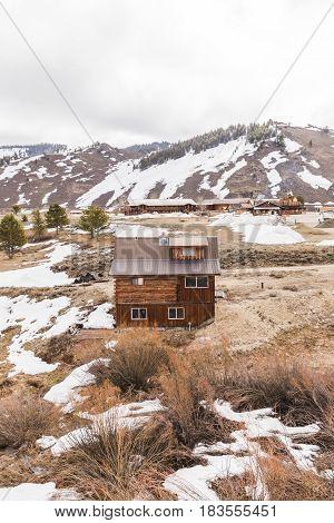 Log Cabin In Snowy Mountain Town