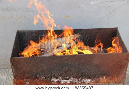The fire is burning in the grill for cooking