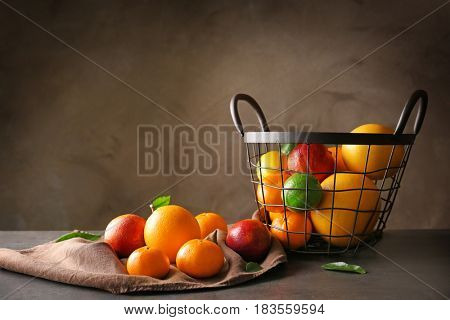 Composition with fresh citrus fruits on dark background