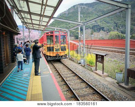 SAGONO RAILWAY, KYOTO, JAPAN - April 6, 2017 : Sagano Scenic Railway (Romantic Train) is Best Sightseeing Train Line Runs Along the Hozugawa River between Kameoka.