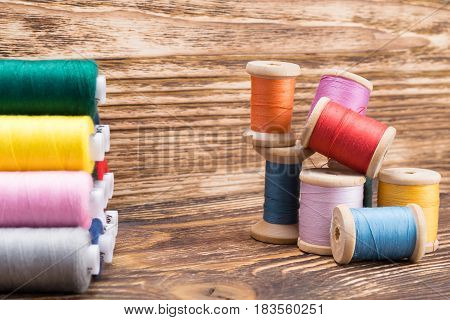 Mountain of new thread reels and old threads