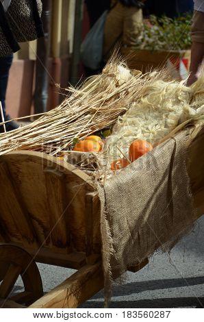The Orange fruits in wood wheelbarrow .