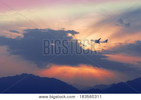 Image symbolizing traveling by aircraft, above Jordanian mountains at the Middle East