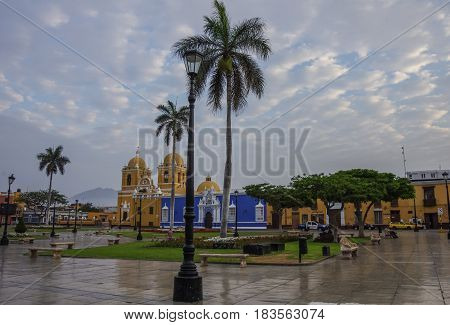 Trujillo, Peru - January 11, 2014: Bright yellow colonial style Cathedral in the Plaza de Armas of Trujillo in early morning Peru