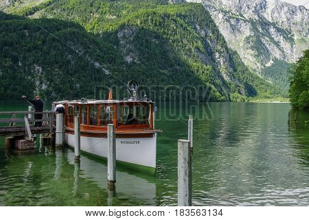 Koenigssee, Germany - August 16, 2010: Tourist boat on pier. Mountain lake Koenigssee Bavaria