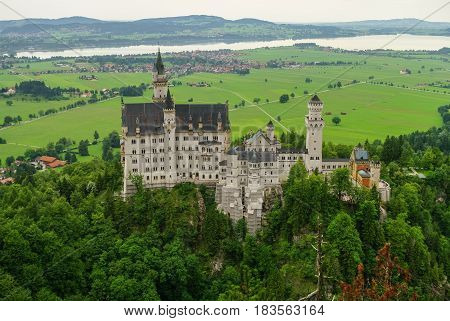 Beautiful view of world-famous Neuschwanstein Castle the 19th century Romanesque Revival palace built for King Ludwig II with scenic mountain landscape near Fussen southwest Bavaria Germany