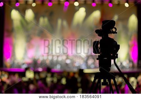 Video camera in the background of concert, bokeh