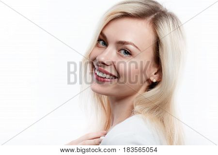 Beautiful woman smiling face close up studio on white