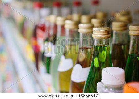 Bottles on a shelf in a supermarket