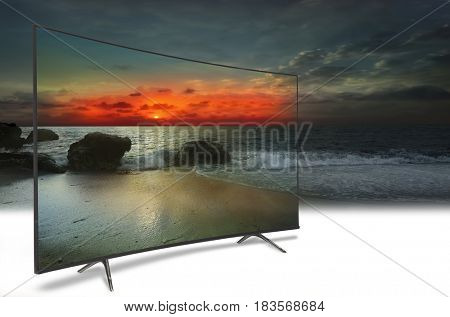 4k monitor isolated on white. TV to the ocean. Sunset. above the sea. Conceptual idea