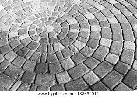 Background Gray And White Circular Paving Slabs. Paving Slabs, Laid Out In Circles In The City Park