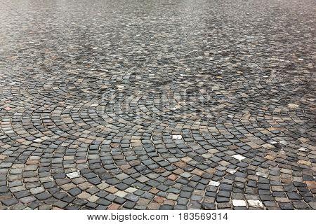 granite pavement after rain