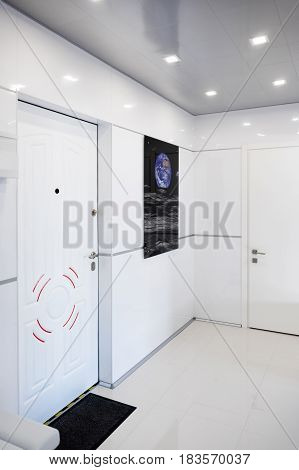 Modern home hallway interior. White plactic panels and tiles. Futuristic interior concept design. Space ship at home. Elements of this image furnished by NASA.