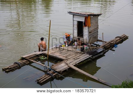 Kalimantan, Indonesia - september 20, 2015: Kalimantan family bathing and washing on their floating bathroom in Kalimantan, Indonesia