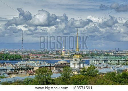 Saint-Petersburg, Russia - May 15, 2006: Main tower of Admiralty and Peter and Paul Cathedral, towering over roofs of St. Petersburg