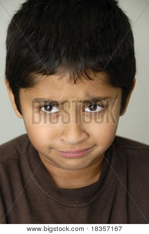 An handsome Indian kid looking very sad