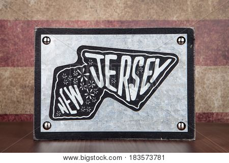 A table top sign in the shape of the State of New Jersey