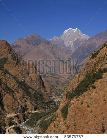 Distant view of Tatopani and mount Nilgiri. Popular place with natural hot spring. Annapurna Conservation Area Nepal