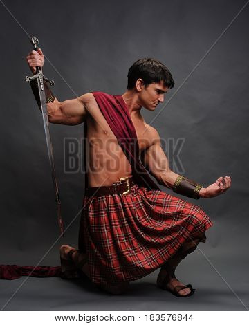 The sexy highlander is ready for action.