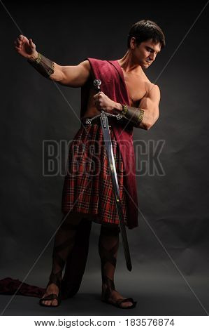 The tough highlander is prepared for battle.