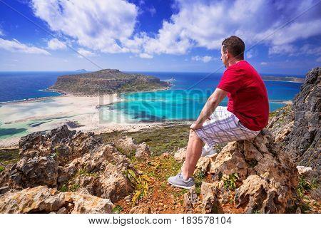 Man watching beautiful Balos beach on Crete, Greece