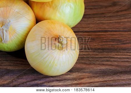 onion and wooden surfaces Onion on the wooden background