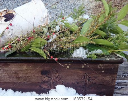 This old window box is filled to the brim with a Christmas scene of birch, juniper and berries.