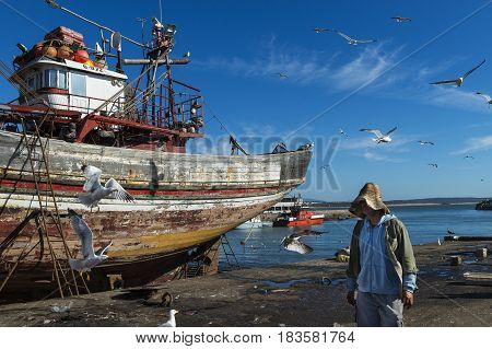 Essaouira Morocco - April 15 2015: Fisherman in the fishing harbour of Essaoira in the Atlantic Coast of Morocco Northern Africa.