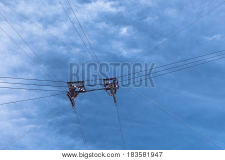 Cable Car Wires And Pulleys Suspended In Cloudy Sky