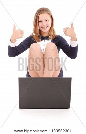 Happy student teenage girl with laptop holding thumb up. Isolated on white