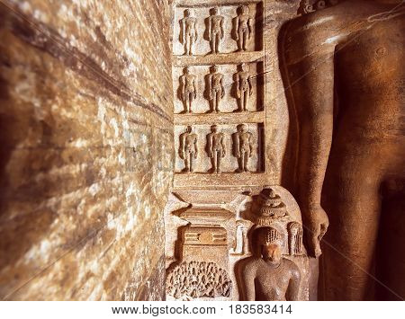 Carved architecture of India. Figurs of Jainism inside the 7th century cave temple in town Badami, India.