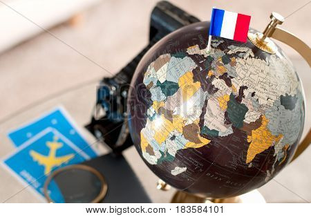 Air Ticket And French Flag On Globe