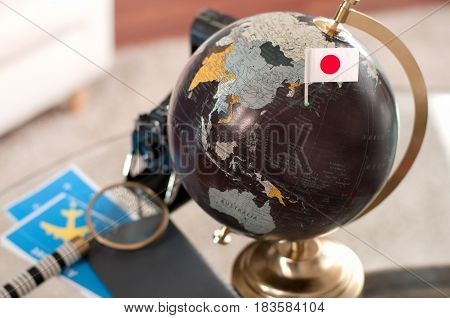 Air Ticket And Japanese Flag On Globe