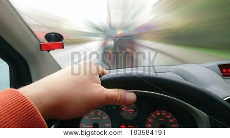 First Person View of Driver Behind the Wheel During Driving a Car. Point of View Shot of Driving a Car. Drivers POV shot.