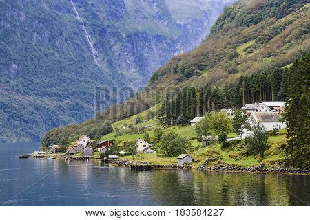 Bakka village in Naeroyfjord in Norway. Bakka is a tiny village located on the western shore of the Naeroyfjord, one of the major tourist attractions in the country