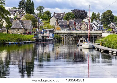 Fort Augustus, United Kingdom - August 19, 2014: The caledionan canal at the Loch Ness lake. The Canal connects the Scottish east coast at Inverness with the west coast at Corpach near Fort William