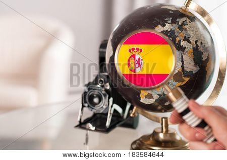 Spanish Flag On Globe Through Magnifying