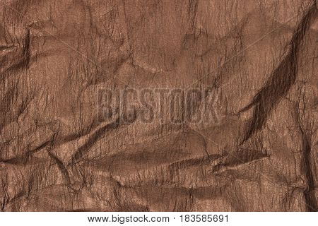 Crumpled brown paper texture. Recycled paper background.